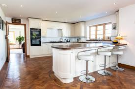 an unique interpretation of the art deco era where even the kitchen and bathroom fittings wood finishings flooring and fitments complement the style