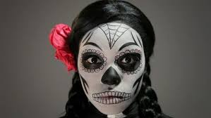 woman wearing day of the dead skeleton makeup