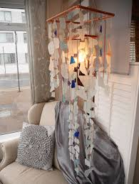 this glass chandelier is made from 100 recycled materials glass from gin and whisky bottles are combined with panes of broken windows and tumbled into a