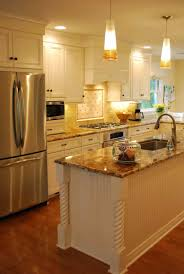 Warm White Kitchen Remodel, Rochester, NY. Cabinetry  Mosaic Tile Appliances Granite Stainless Steel