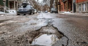 Montreal Workers Are Putting Asphalt Right On Top Of The