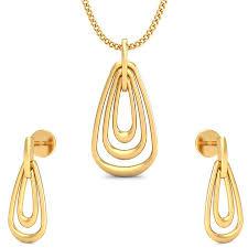 the gracious pendant earring set gold