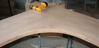 first why did you laminate 2 pieces for the edge the corner could be segmented using pinch dogs to glue it up make a template out of mdf and
