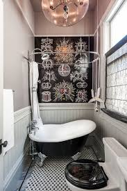tubs for small bathrooms bathroom with accent wall acrylic slipper clawfoot tub wallpaper chandelier shade on