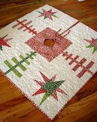 13 Christmas Tree Skirt Quilt Patterns | FaveQuilts.com & Evergreens and Stars Quilted Tree Skirt Adamdwight.com