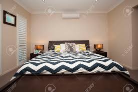 Master Bedroom And Master Bedroom With King Size Bed And Air Conditioning Stock Photo