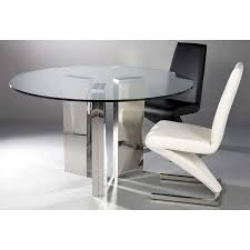 round tempered glass table with black and white leather chairs