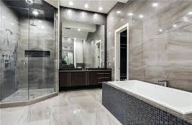 modern master bathroom with gray limestone walls and rainfall shower bath vanities design ideas