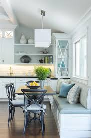 Eat In Kitchen with Built In Dining Bench: Lovely eat-in kitchen is filled  with a built-in dining bench and window seat facing a French bistro table  lined ...