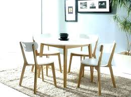 black round dining table set with red chairs