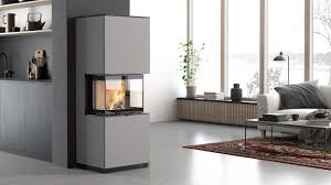 The scandinavian wood stove adds warmth to the modern space. Wood Burning Stoves Fireplaces Scandinavian Contura
