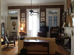 ... Rustic Apartment Living Room Hangs Many Picture Frame on The Wall with  Wooden Furniture and White ...