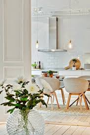modern kitchen dining table chairs white wall tiles