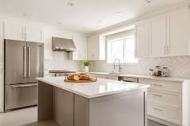 white shaker cabinets with quartz countertops. white shaker cabinets with herringbone backsplash quartz countertops .