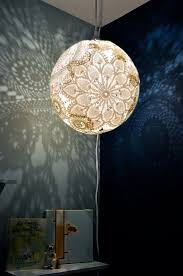 DIY doily lamp. You can make this for less than $10 if you're