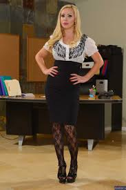 Nikki Benz gets nailed on her work desk in stockings Naughty.