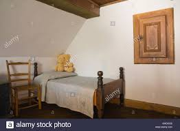 Quebec Bedroom Furniture Old Wooden Chair And Single Bed In A Bedroom In Old 1785