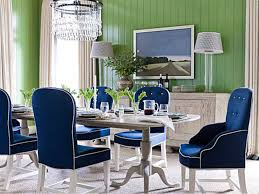 amazing dining room with blue upholstered chairs long table white chandelier cabinet standing l in green