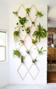 wood and leather wall hanging planter