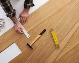 carpenter installing a wooden flooring flooring contractors in woodhaven ny