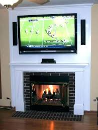 hiding wires on wall nted above fireplace hanging a flat screen over gas nting how to
