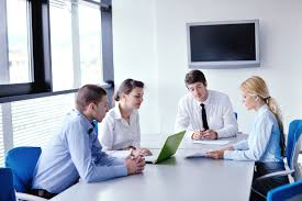 office meeting. Business People In A Meeting At Office - Livewire Digital Kiosk Software
