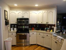 antique white cabinets with brown glaze after photos