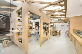 intersecting planes architecture. produce intersects two retail spaces with plywood planes in singapore intersecting architecture s