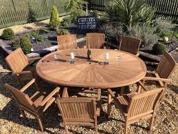 teak premium oval table with 8 teak