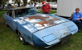 An unrestored 1969 Dodge Daytona, looking like it's had a really ...