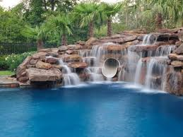 inground pools with waterfalls and slides. A Waterfall Not Only Helps To Increase The Value Of Your Home, It Can Also Be Relaxing And Fun. This Here Has An Integrated Water Slide. Inground Pools With Waterfalls Slides