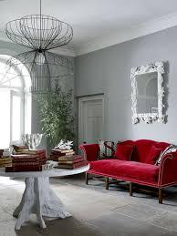 grey walls red sofa red sofa living