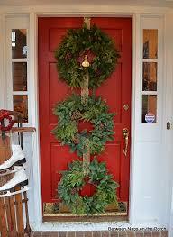 how to hang garland around front doorChristmas Door Ideas Decorate with Triple Wreaths
