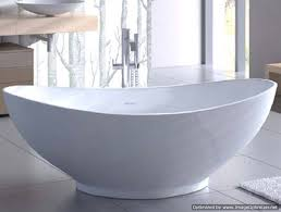 oval freestanding tub with raised back rests center drain