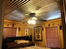 interesting tin ceiling framed by and groove pine siding on rustic sheet metal corrugated sheets