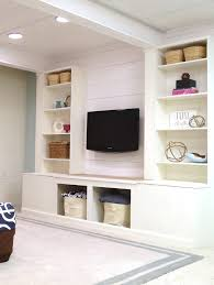 diy built in media wall unit with extra storage from an ikea bookcase
