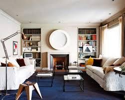 stylish small apartment decor dark blue area rug comfortable white sofas simple standing lamp white walls