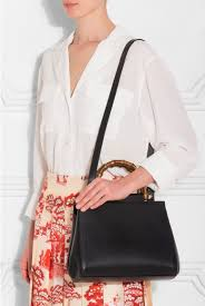 gucci top. black nymphaea leather top handle bag gucci