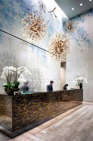 brandon barré on hotel reception deskfront