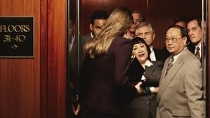 awkward people in elevator. hopefully she is being sweet because there are some angry faces. awkward people in elevator