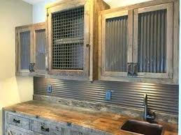corrugated metal and painted cabinets wire cabinet doors back splash laundry room metals black with glass