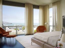 View in gallery Gorgeous curtains bring an air of femininity to the bedroom  [Design: Chloe Warner]