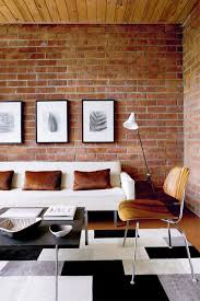 the brick living room furniture. Fake Exposed Brick Wall In Living Room With Picture Frame White Sofa Brown Cushion Plus Metal Coffee The Furniture E