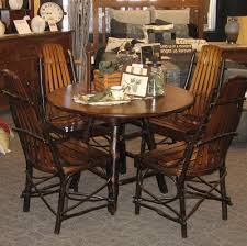 Round Rustic Hickory And Brown Maple Dining Table Shown In - Amish oak dining room furniture