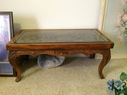 hand carved table coffee table and was wondering what it might be worth i do not hand carved table