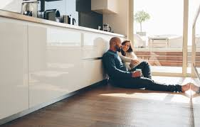 couple enjoying increase value of new flooring in their home