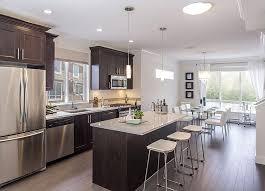 Traditional Kitchen with Kitchen island, Pental quartz super white, flush  light, AFX Pendant Light, Undermount sink