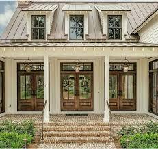 exterior metallic bronze paint. brown metal roof. doors. exterior metallic bronze paint