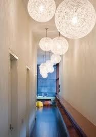 Narrow hallway lighting ideas Foyer Furniture Grunsfeld Shafer Architects Image Via Houzz Carla Aston Diy Cures For The Claustrophobia Caused By Long Narrow Hallways