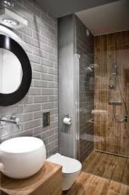 wood grain tile shower with gray subway tile walls/decordemon: A mix of  Scandinavian style with Victorian accents.